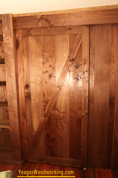 walnut hanging barn door on sliding track